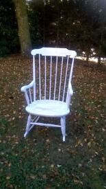 Wooden rocking chair, partly painted for distressed look.