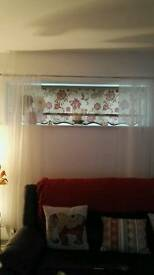 Red and cream roller blinds