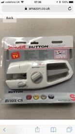 Singer hand held sewing machine, sew on buttons