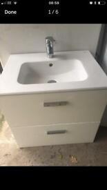 White gloss vanity sink unit wall hung with tap