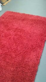 Red wool rug in new condition
