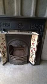 Cast iron fireplace with tile inserts & open fire grate