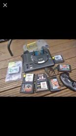 Mega drive bundle with 8 games and other bits