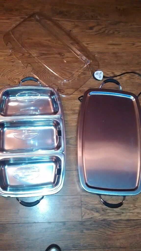 Heated serving dish ideal for parties to keep food warm