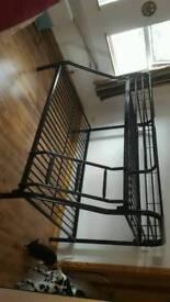 Black metal double below single above bunk bed