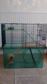 Large hampster cage wijth wheel, feeding bowl, & accessoriez & toys