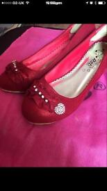 Beautiful girls red heeled shoes