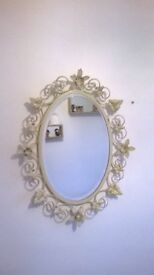 Oval glass mirror.