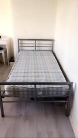 2 x single metal bed frames one with mattress one without