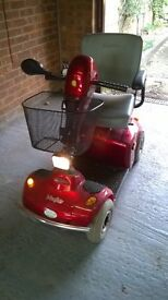 Wayfarer mobility scooter with rain cover , good condition.