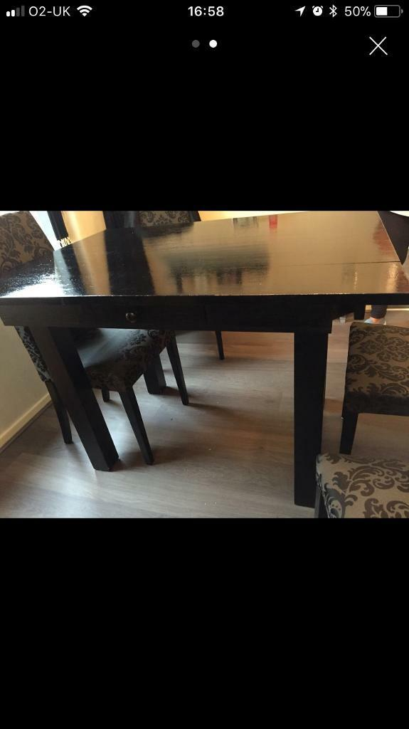 Black solid heavy wood dining room table £20