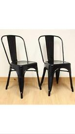 Two gloss black industrial style dining chairs