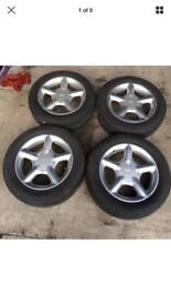 FORD 195/60 15 4 STUD 5 SPOKE 15 INCH ALLOY WHEELS WITH TYRES