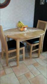 Extending table with 2 chairs