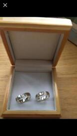 Celtic 9 ct white gold engagement and matching wedding rings