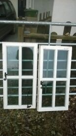 2 identical double glazed wi dows