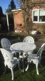Cast aluminium Victorian style garden table and 4 chairs