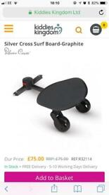 Silver cross surf board.