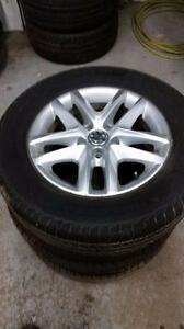 215 65 16 / 235 50 18 tires on OEM VW Tiguan alloy rims 5 x 112