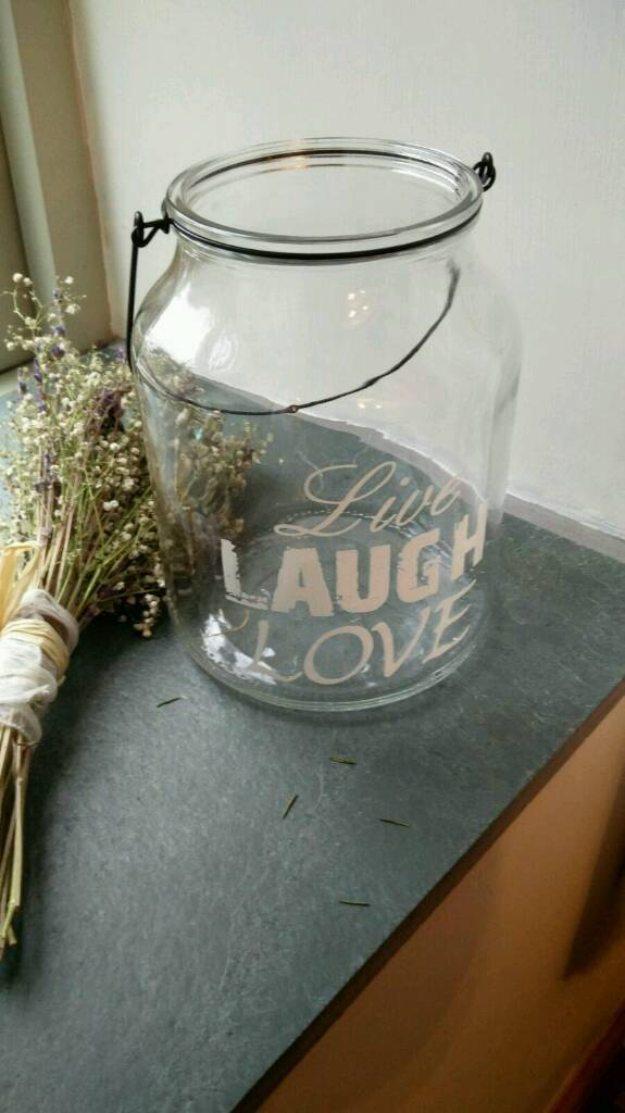 Live, Laugh, Love lanterns used to hold candles and fairy lights in our wedding