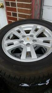4 Used 215/60/16 Tires on Chev Cruise Rims