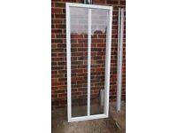 Bi- fold shower door