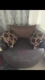 Brown large swivel chair