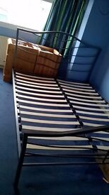 Kingsize metal bed frame with slats