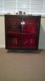 Ikea, Dark brown storage unit. 4 red drawers. Good condition.