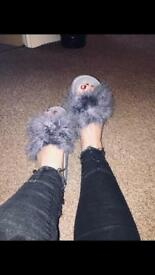 Grey fluffy sliders