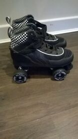 black quad roller skates in nearly new condition size 7