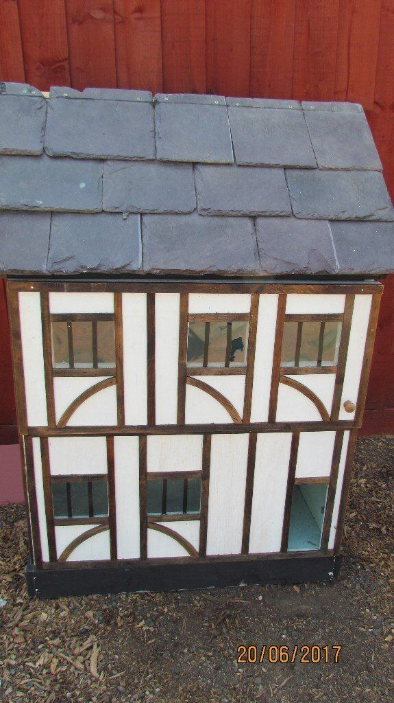 LARGE WOODEN DOLLS HOUSE WITH SLATE ROOF