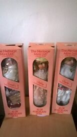 Set of 8 vintage porcelain dolls in boxes with stands