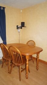 Solid pine dining table (extendable) with four chairs (sold)