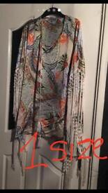 Lovely silk cover up with tassels 1 size.