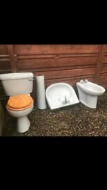 Coloured retro bidet, sink and toilet for quick sale.