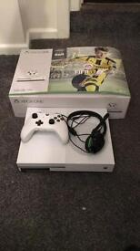 Xbox one s bundle comes with Fifa 17, cod remastered and a headset, only been used for two months