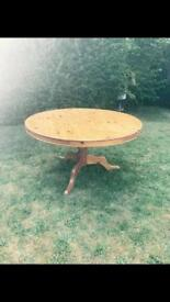 Round hardwood dining table and 6 chairs