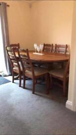 Large heavy dining table with 6 chairs