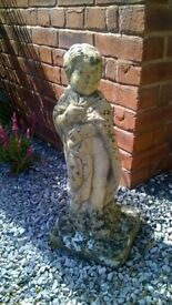 Stone Statue of Boy, old and charming