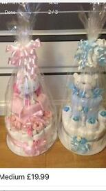 Baby nappy cakes - medium £19.99, large £24.99, gift baskets - £29.99, blue or pink