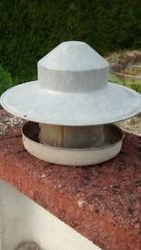 Galanised metal poultry feeder.