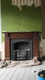 Cast iron fire with wooden surround
