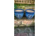 Two medium size blue planters