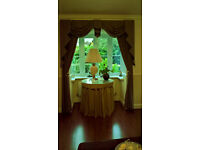 Two pairs of elegant blue/gold small check curtains with swag and tails pelmets