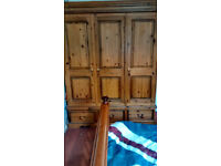 solid heavy pine triple wardrobe and tall drawer unit.