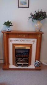 Electric fire complete with fireplace surround
