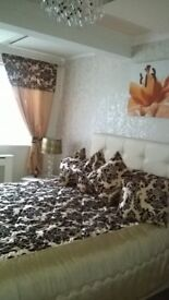 66x72 Gold and Black curtains, king size black and gold throw with shams, cushions, lamshade.