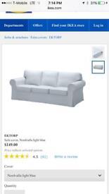 Two light blue IKEA sofa covers
