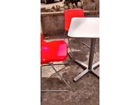 IKEA small white table and 2 red chairs